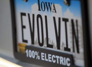 Iowa license plate, 100% electric badge